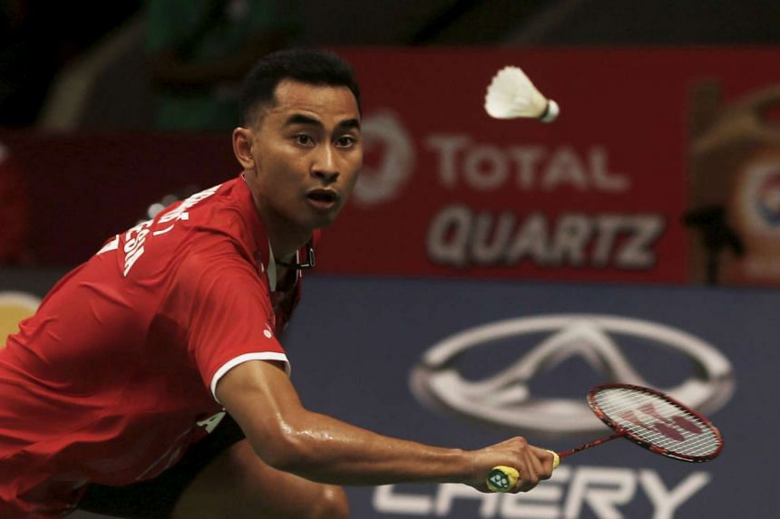 Indonesia's Tommy Sugiarto hits a return to Spain's Pablo Abian during their men's singles badminton match at the Total BWF World Championship in Jakarta, on Aug 10, 2015.
