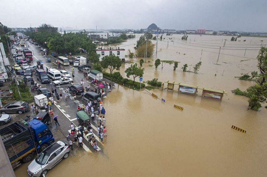 Flood waters cover parts of Pingyang county in east China's Zhejiang province on Aug 9, 2015.