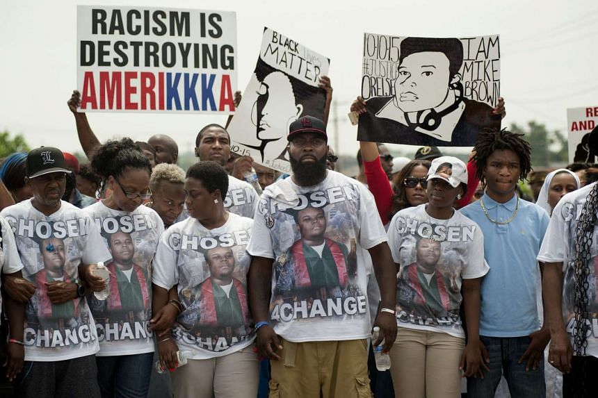 Michael Brown Sr. (centre) leads a march in remembrance of his son, Michael Brown Jr., in Ferguson, Missouri, USA, on Sunday.