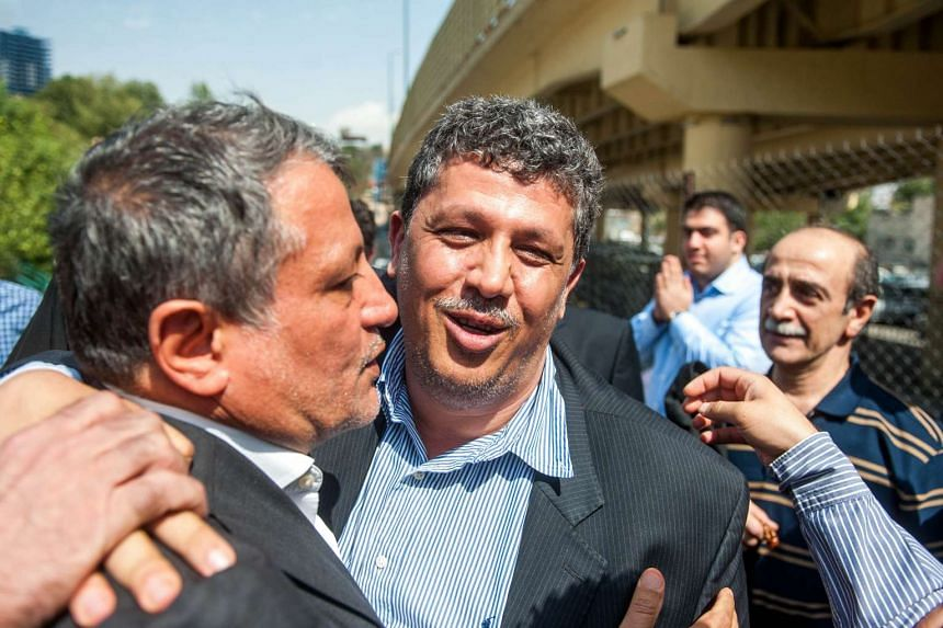 Iranian Mehdi Hashemi Rafsanjani (centre), the son of Iran's former president Akbar Hashemi Rafsanjani is hugged by his brother Mohsen (L) outside Tehran's Evin prison on Sunday before entering the prison to begin his 10-year term.