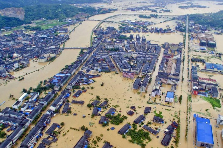 An aerial view shows a flooded town in Pingyang county after typhoon Soudelor caused floods and mudslides, in Zhejiang province, China, on Saturday.