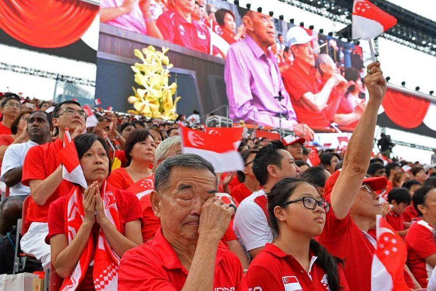 Spectators at the National Day Parade 2015 held at the Padang.