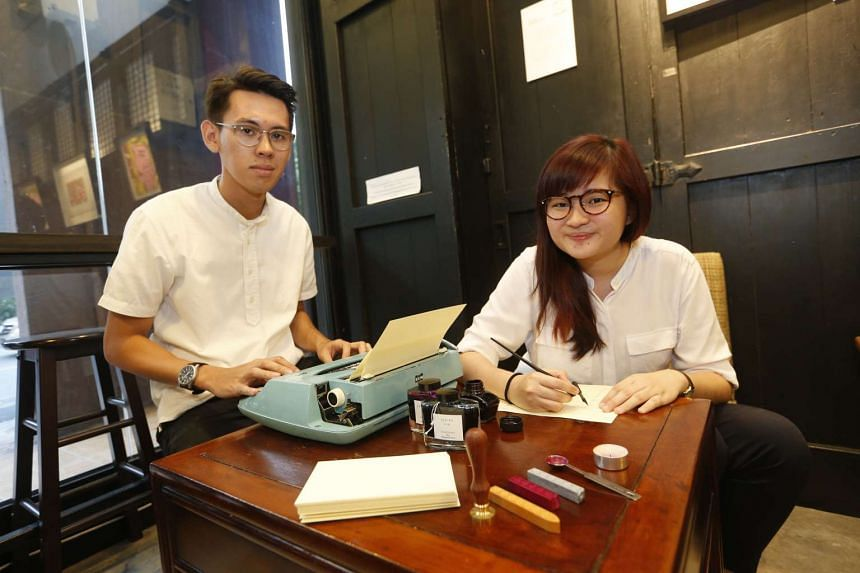 In their letter-writing service, Mr Tung Yaowen Kamal Adam uses a typewriter while Ms Abigail Tan writes with a traditional dip pen.