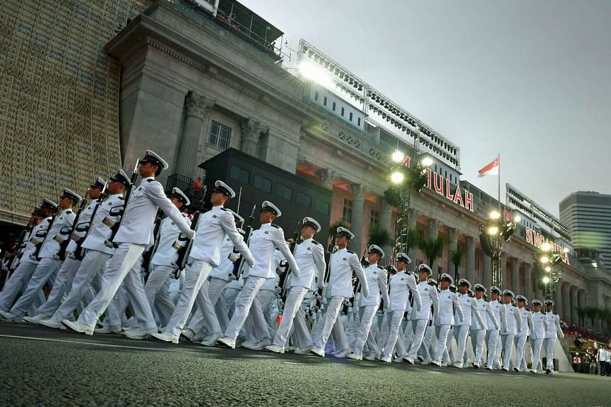 Members of the elite Naval Diving Unit (above), who made up part of the Guard of Honour contingent.