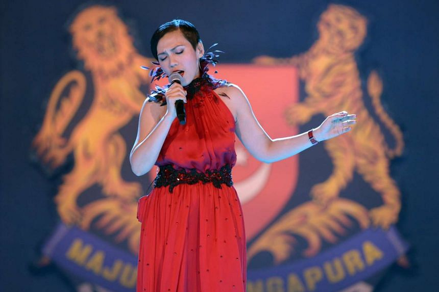 Singer Kit Chan, 42, wrapping up the evening with her version of Home, which she first performed at the 1998 parade. She told reporters after the Aug 1 preview show that this year's parade would likely be her last.