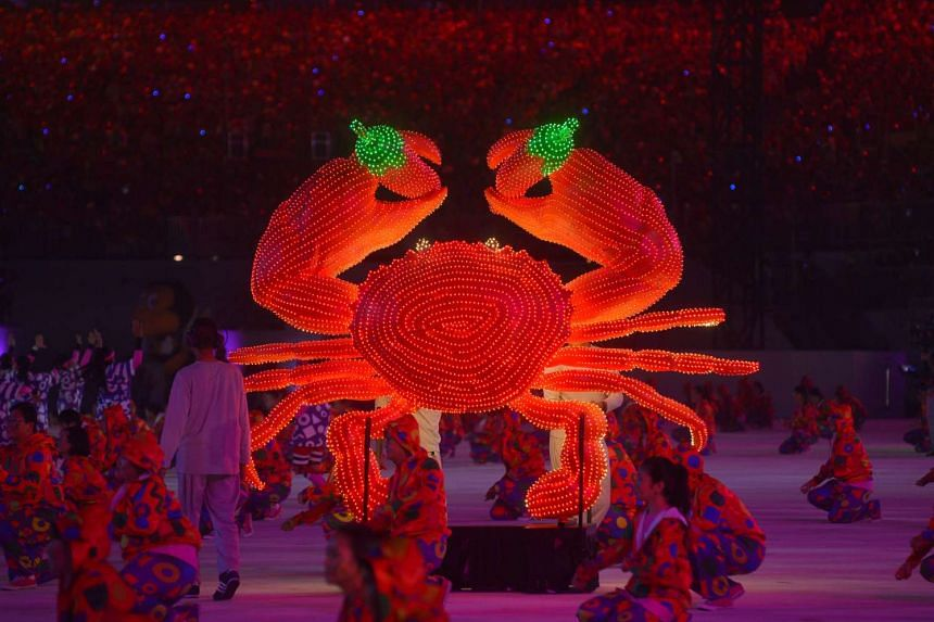 More than 500 performers from the People's Association put up a lively dance performance incorporating 12 large props showcasing the nation's unique identity, and things Singaporeans hold close to their hearts, including chilli crab (above), Sing