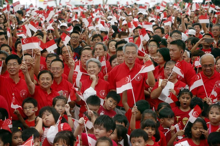 PM Lee Hsien Loong (centre) and his wife, Ms Ho Ching, joined more than 3,000 residents and schoolchildren at the Teck Ghee National Day Observance Ceremony, which was held yesterday morning in an open field in Ang Mo Kio.