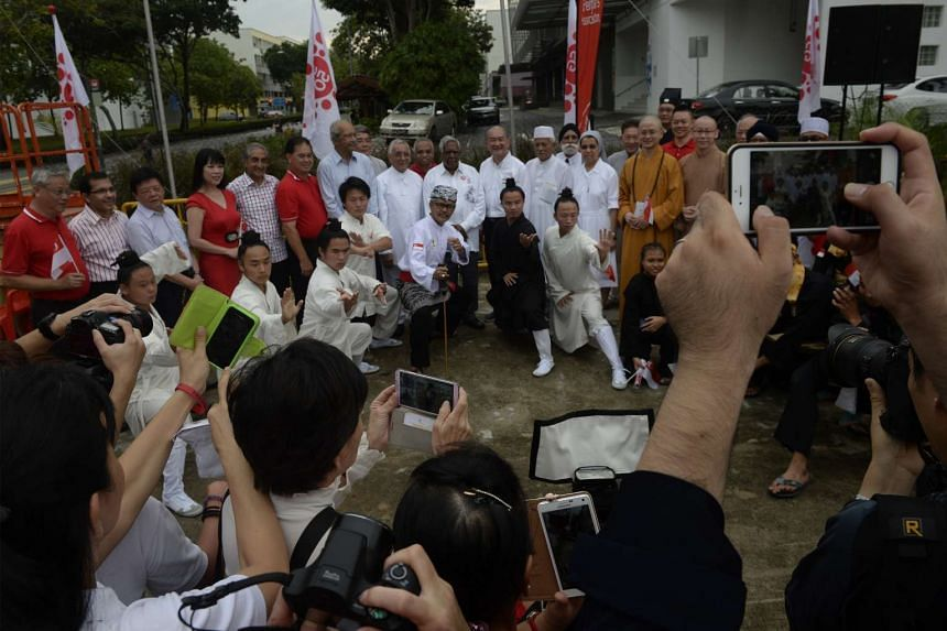 Former president S R Nathan (above, centre), with representatives from 10 religious groups, attending a National Day observance ceremony at the Lorong Koo Chye Sheng Hong Temple in Paya Lebar yesterday.