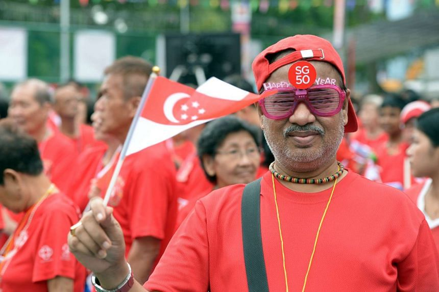 Smiles aplenty as revellers in Lower Delta Road, Marine Parade and Mountbatten Community Club (above) get festive for the nation's birthday.