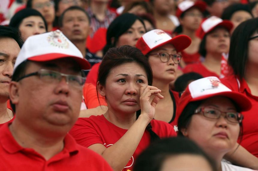 A hush fell over the crowd and many wiped away tears during the video tribute to the late Mr Lee Kuan Yew. The founding prime minister never missed a National Day Parade.