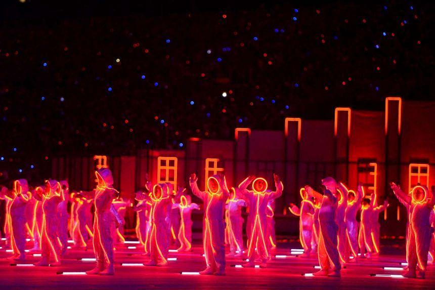 More than 500 primary school pupils lighting up the stage in LED suits in the Onwards - Bright Future segment.