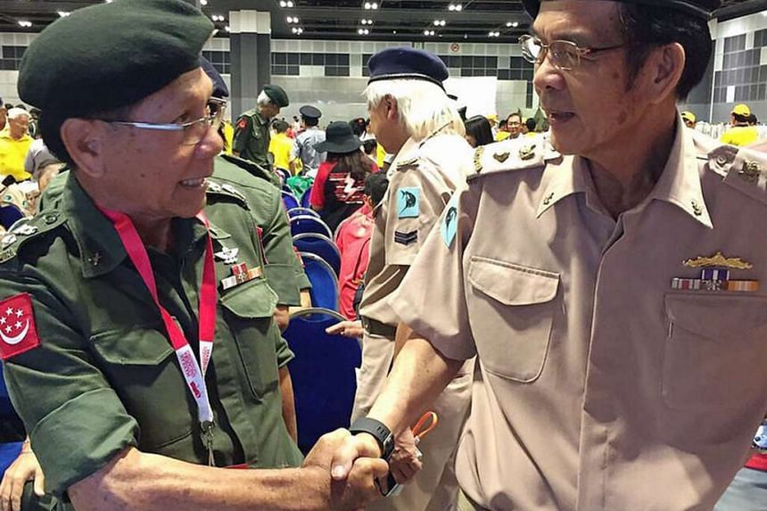 Former military buddies and retired lieutenantcolonels Swee Boon Chai (left), 69, and Wong Ko Foon, 62, catch up before they take part in the vintage parade.