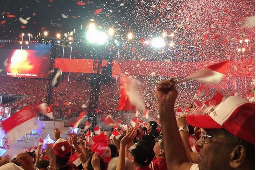 Red and white confetti blanket the night sky above the spectators at the Padang as fireworks of bring the SG50 celebration to its climax.