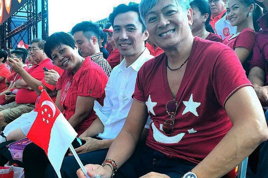 NDP creative director Dick Lee (far right), who composed the theme song Our Singapore, is all smiles as the parade plays out before him.