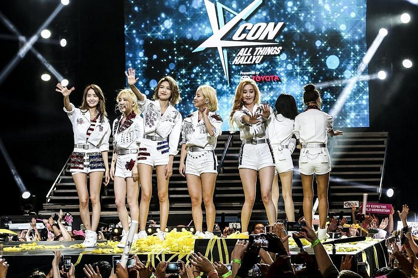 K-pop stars Teen Top (left) and Girls' Generation (above) drove the crowd mad at KCON at the Prudential Center in Newark.