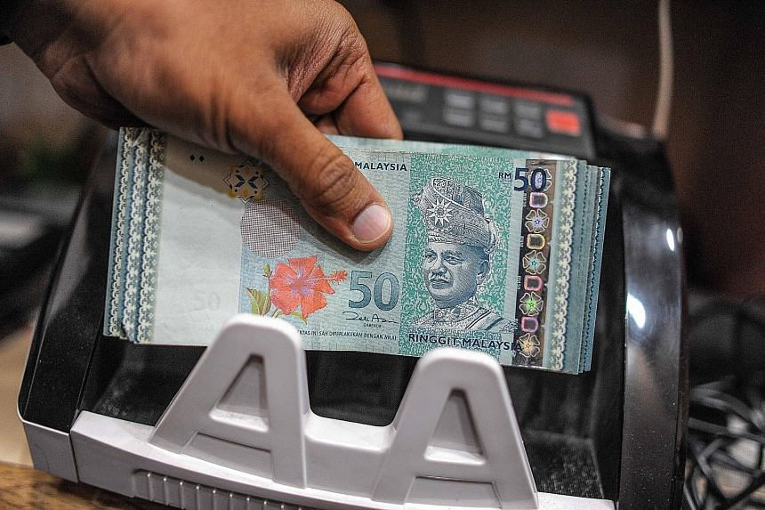 The ringgit yesterday fell to 3.9300 per US dollar, the weakest level since Sept 2, 1998, the day before the government pegged it at 3.8000 per dollar to put a floor under the unit in the Asian financial crisis.