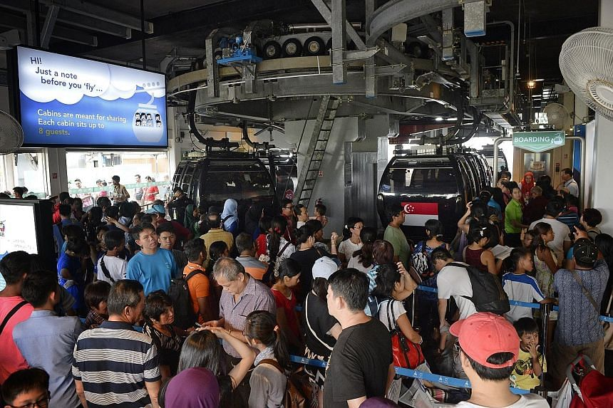 Mount Faber Leisure Group's offer of complimentary cable-car rides drew long and snaking queues yesterday. It was part of its SG50 Jubilee Weekend promotion. Many Singaporeans also took the opportunity of free or discounted tickets to visit attractio