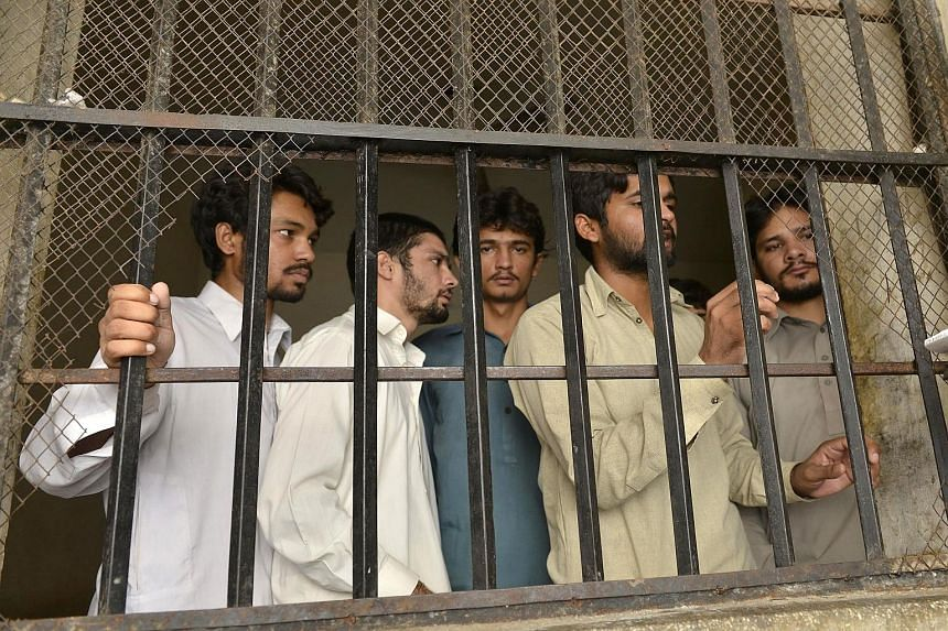 Accused gang members in a police lock-up in Husain Khan Wala village, 55km south-west of Lahore. The police have arrested 12 people after media reports on the alleged abuse led to a public outcry.