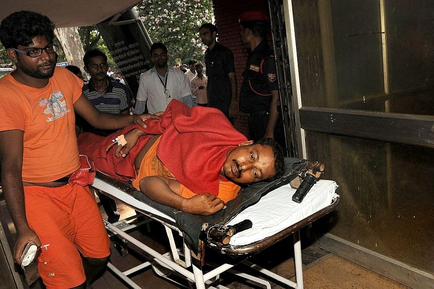 An injured pilgrim being taken to hospital yesterday after a stampede at the Baidyanath Jyotirlinga temple complex.