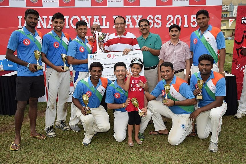 Above: The victorious India team with minister S. Iswaran (in red-and-white top) after claiming the League of Nations trophy at the Indian Association's National Day Sixes tournament yesterday. Right: Sri Lanka's Thusara Kodikara getting bowled in th