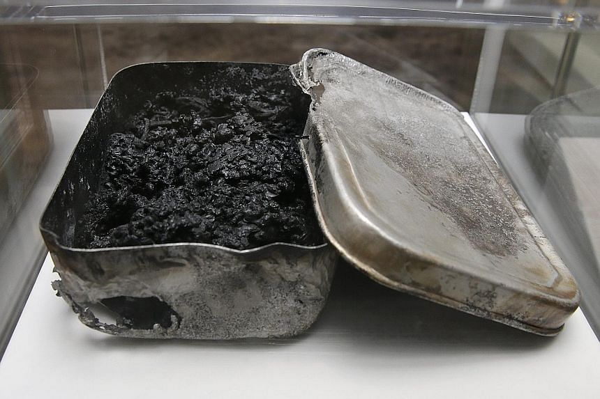 Poignant reminders: A lunch box containing rice that was charred black by the bomb blast. It belonged to first-grader Shigeru Orimem of Hiroshima Prefectural Second Junior High School, who was exposed to radiation while at a house-demolition worksite