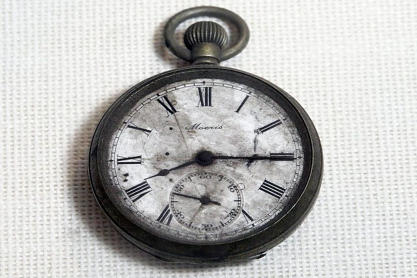 Poignant reminders: A watch that stopped at 8.15am, the time the atomic bomb fell on Hiroshima. It belonged to 59-year-old Kengo Nikawa, who was on his way to work and about 1.6km from the hypocentre. He died on Aug 22, 16 days after the bombing.