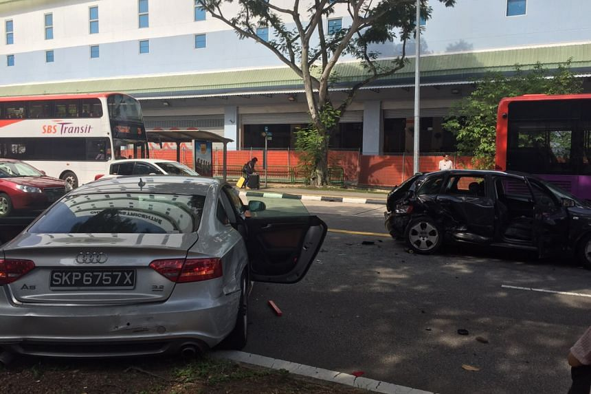 A silver Audi (left) was badly damaged in the eight-car pile-up along Simei Avenue.