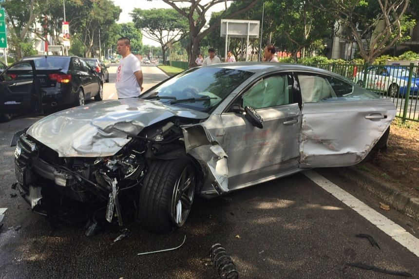 The badly-damaged silver Audi. Eyewitnesses claimed its driver was spotted running away from the scene.