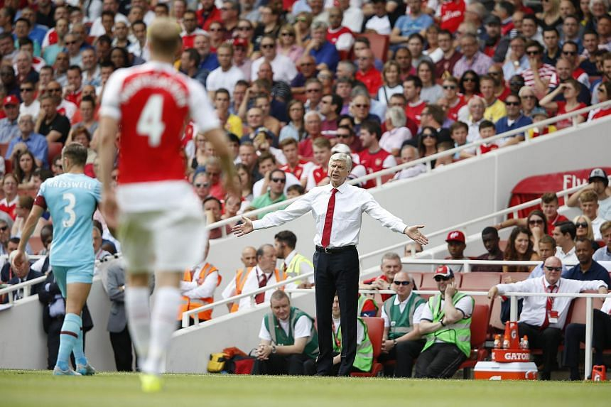 Arsenal manager Arsene Wenger gestures during the English Premier League football match between Arsenal and West Ham United at the Emirates Stadium in London on Aug 9, 2015.