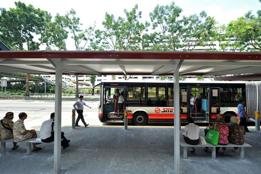 "The bus hub at the pilot site in front of Block 270 Bukit Panjang Road. ""Bus hubs"" are bus stops that have extended bays and shelters."