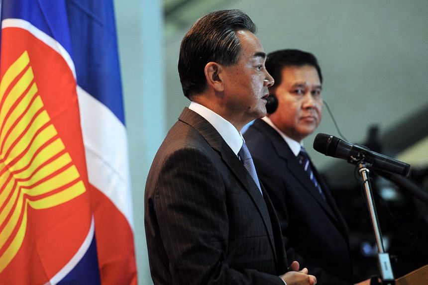 China's Foreign Minister Wang Yi (left) at a joint press conference with Thai Foreign Minister Tanasak Patimapragorn in Kuala Lumpur on Aug 5.