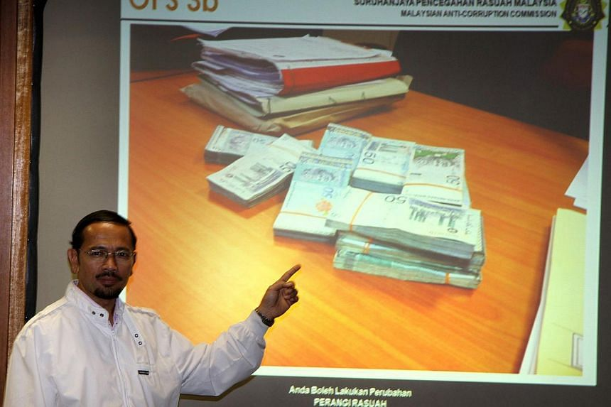 """Acting MACC head Mustafar Ali told reporters that investigations into SRC, named as part of a money trail that saw an alleged RM42 million (S$15 million) deposited into Mr Najib's accounts, would now """"resume as normal""""."""