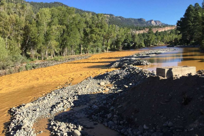 This photograph provided by La Plata County in Colorado on Aug 10, 2015 shows the orange colored Animas River near Durango, Colorado shortly after a toxic waste spill.