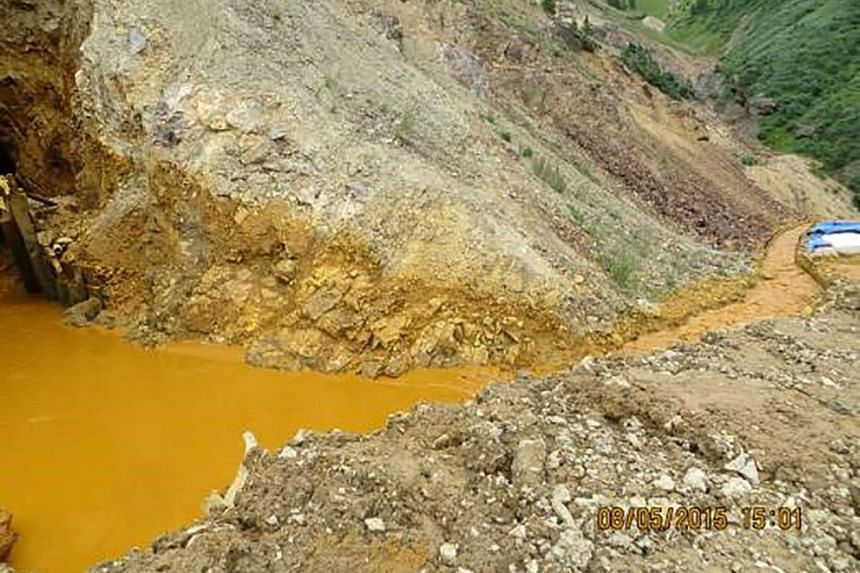 Yellow mine waste water is seen at the entrance to the Gold King Mine in San Juan County, Colorado.