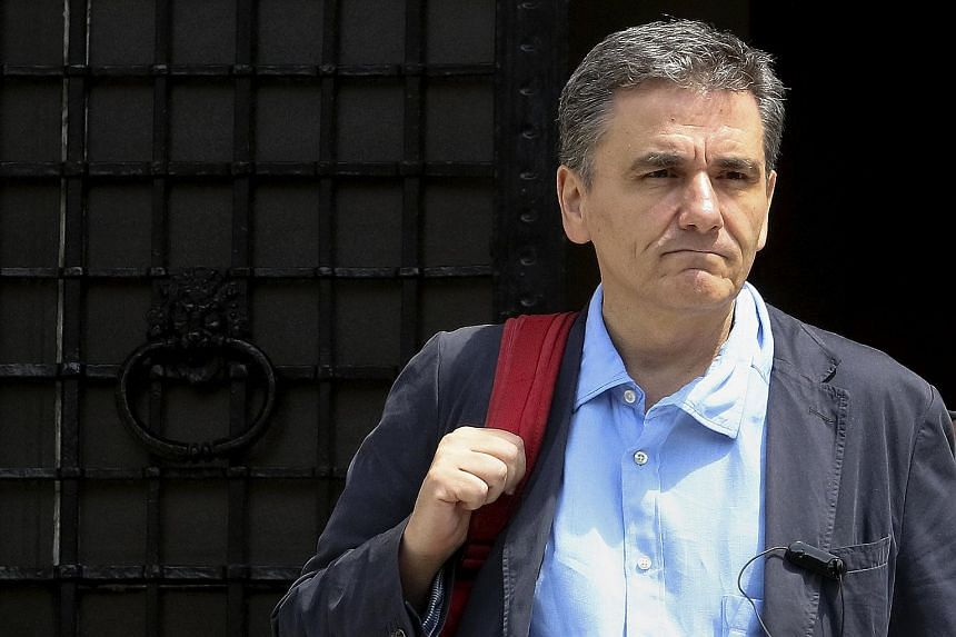 Greek Finance Minister Euclid Tsakalotos leaves the Maximos Mansion after a meeting with Greek Prime Minister Alexis Tsipras (not pictured) in Athens, Greece on Aug 9, 2015.