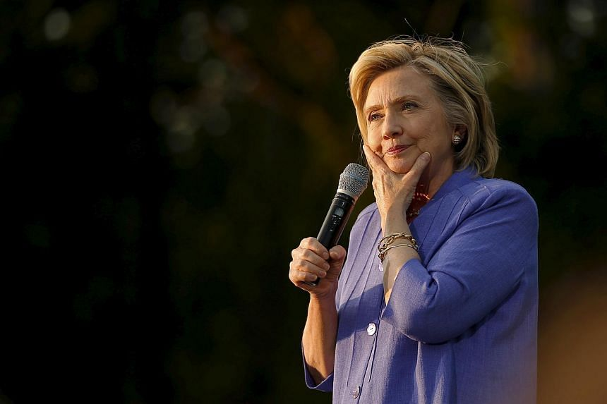 US Democratic presidential candidate Hillary Clinton pauses while speaking at a campaign stop in Manchester, New Hampshire, Aug 10, 2015.