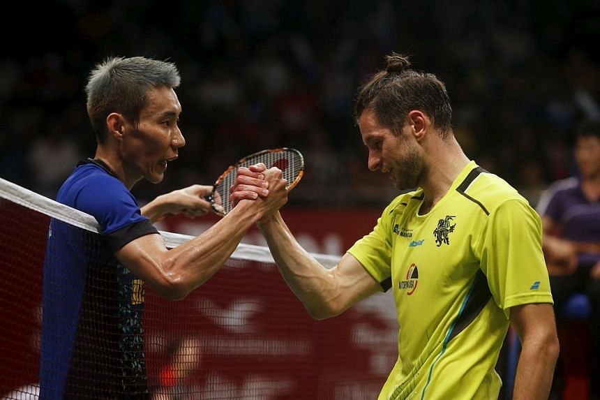 Malaysia's Lee Chong Wei (left) shakes hand with Lithuania's Kestutis Navickas after their men's singles badminton match on August 11, 2015.