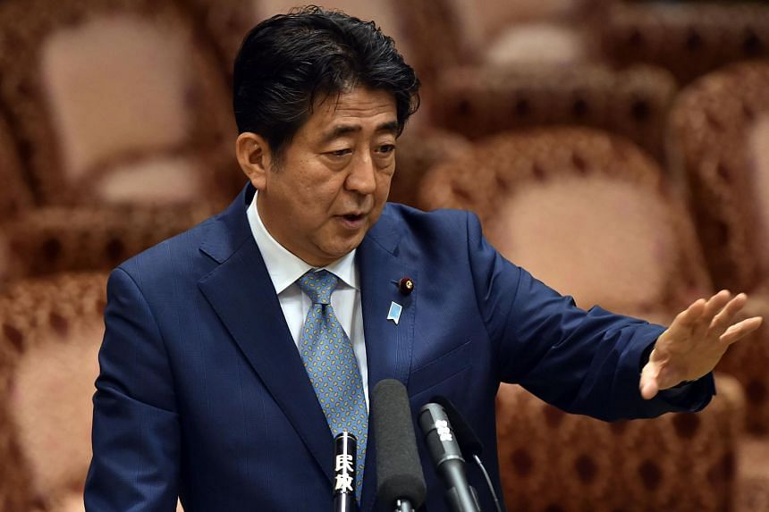 Japan's Prime Minister Shinzo Abe answers a question by an opposition lawmaker during an Upper House budget committee session on Aug 10, 2015.