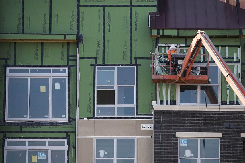 This file photo shows construction workers as they build an apartment building in Virginia, US.