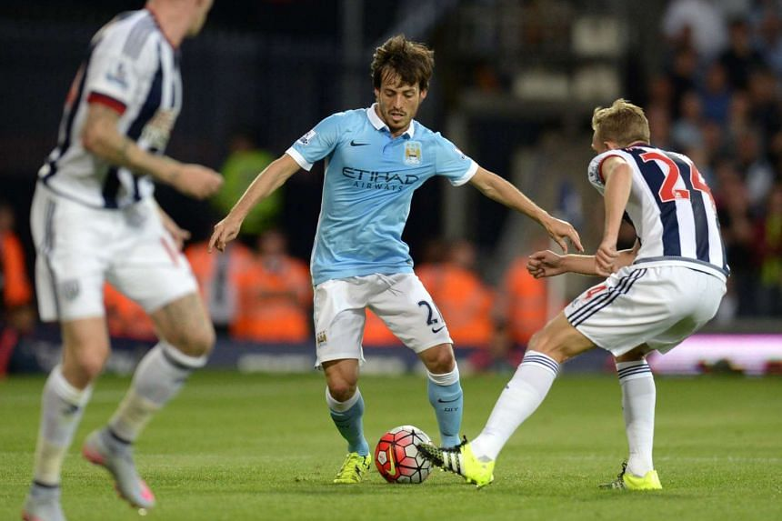 Manchester City's  David Silva (centre) vies with West Bromwich Albion's Darren Fletcher during the English Premier League football match at The Hawthorns in West Bromwich, central England, on Aug 10, 2015.