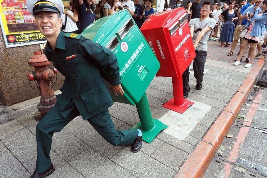 The two letter boxes have become a tourist attraction, with hundreds of people queueing to have their photo taken with them.