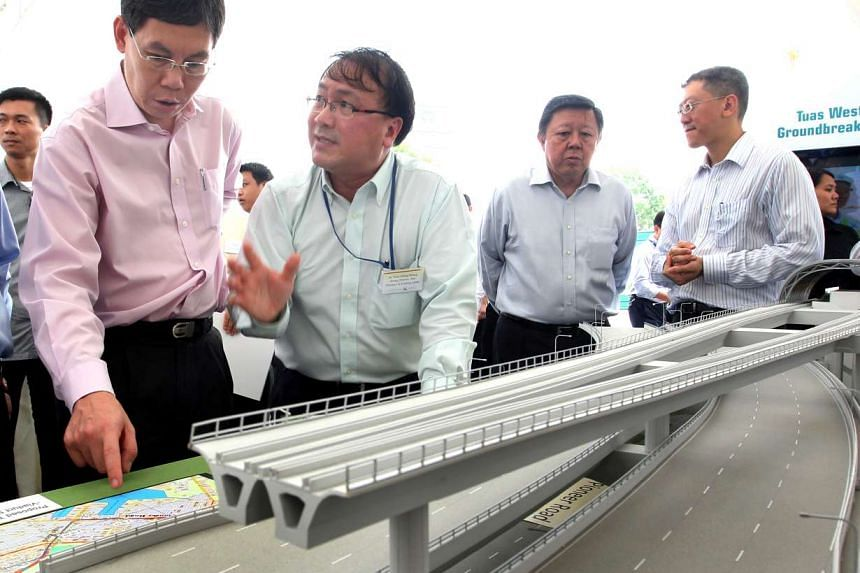 (From left) Transport Minister Lui Tuck Yew, LTA group director of rail (Thomson and Existing Lines) Chua Chong Kheng, LTA chairman Michael Lim, and LTA chief executive Chew Hock Yong, Chief Executive of LTA, at a ground-breaking ceremony for the Tua