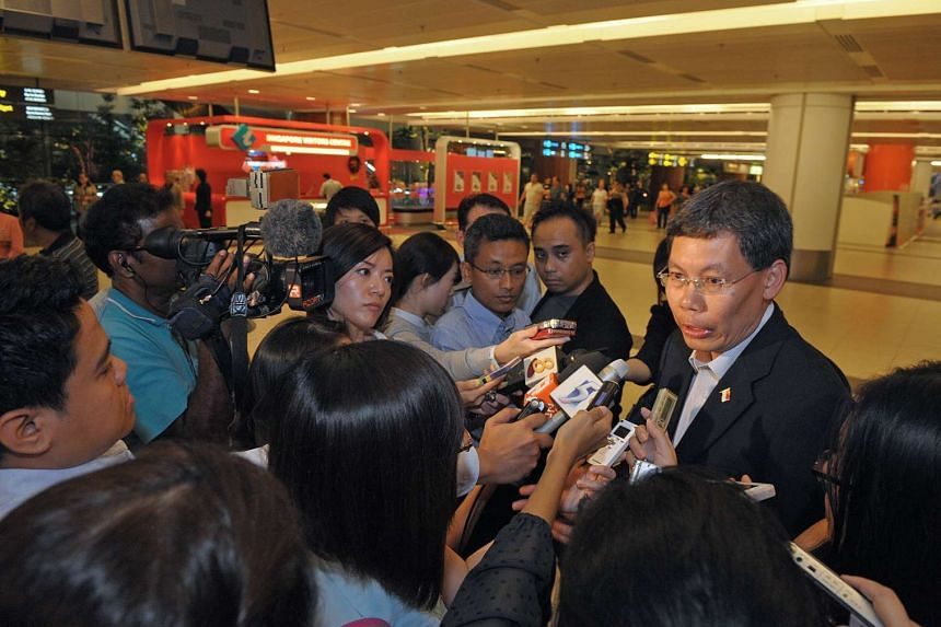 Minister for Transport Lui Tuck Yew speaking to reporters at Changi Airport on Dec 16, 2011, after he cut short a working trip to Cambodia after the SMRT breakdown.