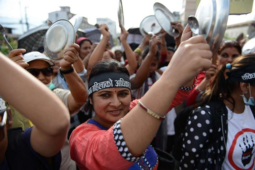 Nepalese activists bang plates and spoons as they take part in a protest demanding equal citizenship rights in the new Constitution in Kathmandu on Aug 10, 2015.