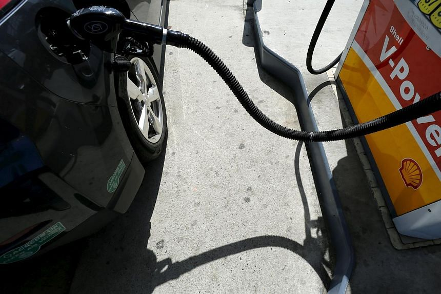 Oil prices slumped on Tuesday following a jump in the previous session, as China devalued its yuan currency.