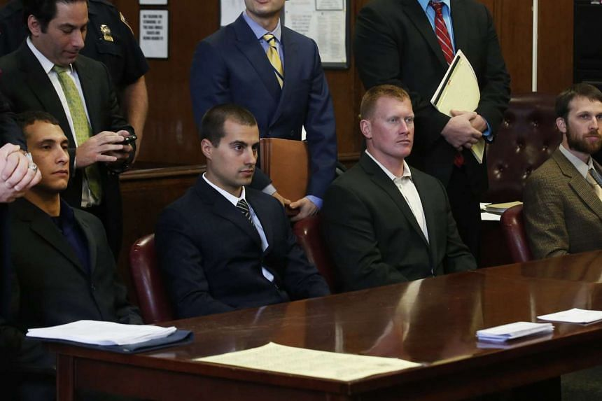 (From left to right seated) Andrew Rossig, Marco Markovich, James Brady and Kyle Hartwell appear in Manhattan Criminal Court in New York May 6, 2014. Rossig and Brady are two of the three BASE jumpers who parachuted from the top of the 104-story One