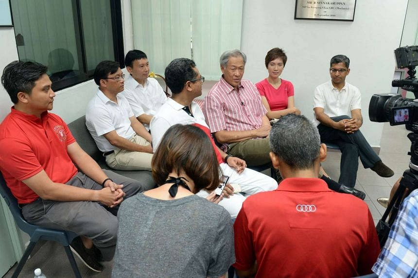 Ng Eng Hen visiting residents with three other Bishan Toa Payoh MPs, Josephine Teo, Hri Kumar and Zainudin Nordin.