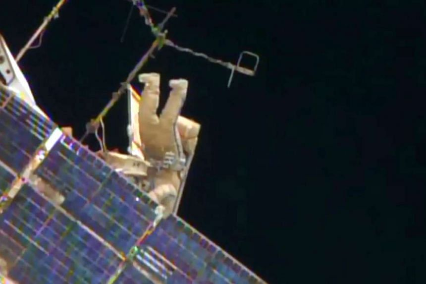 One of two Russian cosmonauts works outside the International Space Station in this Monday image from NASA TV.  ISS Expedition 44 Commander Gennady Padalka and Flight Engineer Mikhail Kornienko of the Russian Federal Space Agency will install device