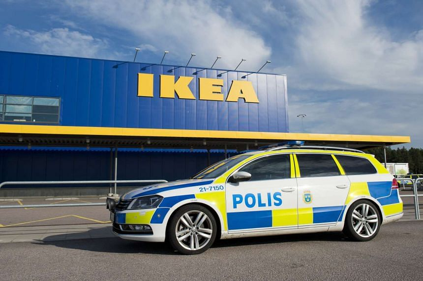 Police cars parked outside IKEA store in the city of Vaesteraas, about 100 km west of Stockholm on Monday. Two people were stabbed to death at the Ikea store in Vasteras and a third person was wounded, police said.