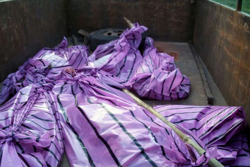 The bodies of five women killed by villagers who accused them of practicing witchcraft lay in plastic bags in Kanjia village in eastern Jharkhand state on Saturday. Villagers in a rural part of eastern India have killed five women whom they accused o